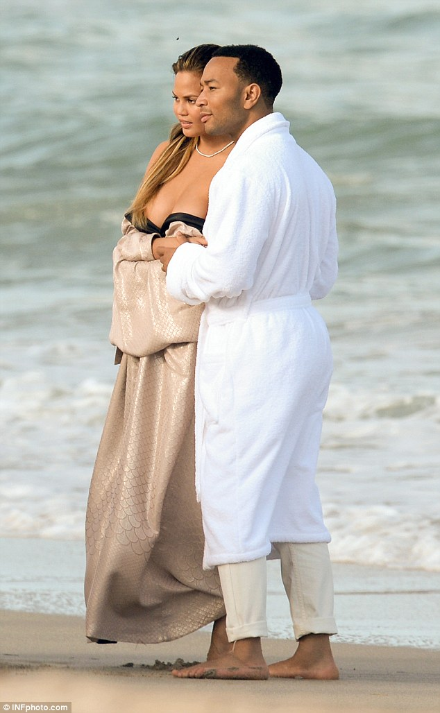 Long day: It was a seemingly endless day of posing and kissing for the couple on the beach