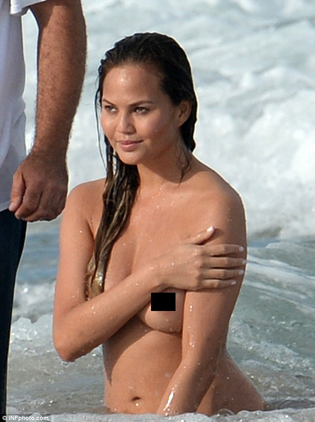 She looks incredible: Her body glistened as she dried off in the sunshine