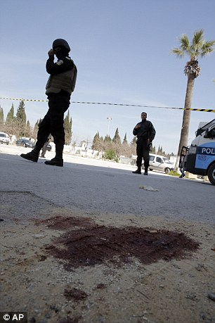 The scene of the massacre today remained covered in bloodstains