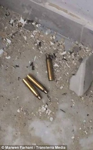 Spent bullet shells can be seen among the debris