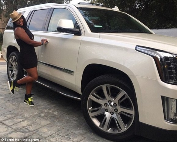Happy birthday: Torrei Hart revealed on Thursday that ex-husband Kevin Hart bought her a Cadillac Escalade for her birthday
