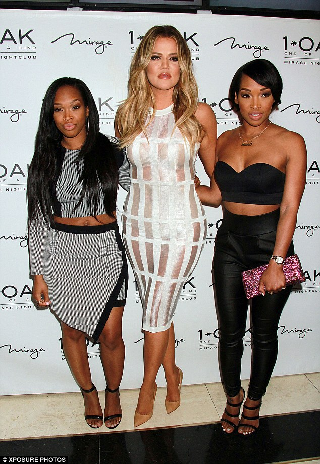 In great compnay: Khloe was pictured with her twin pals, Malika and Khadijah Haqq