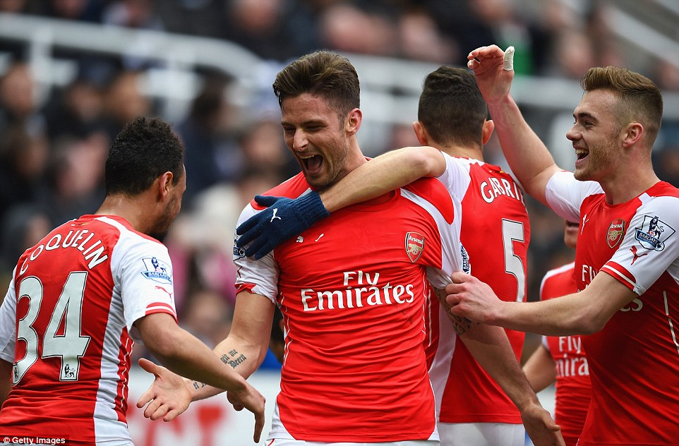 Francis Coquelin (left) and Calum Chambers (right) congratulate Giroud following his second goal of the afternoon