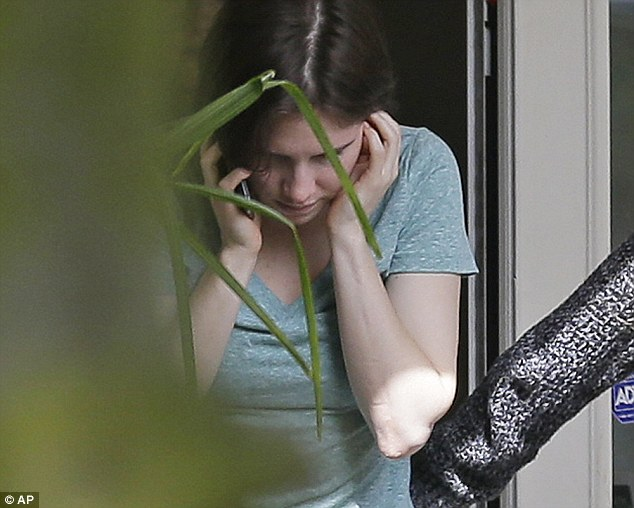Moment of truth: Amanda Knox (pictured on the phone to her lawyer moments ago) said she was 'tremendously relieved after being cleared of murdering her room mate Meredith Kercher in 2007