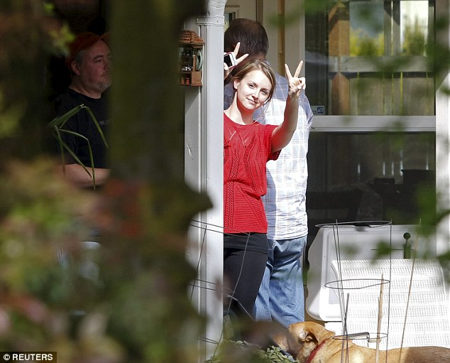 Party: Amanda Knox's friends and family were heard yelling with joy in her mother's home in Seattle