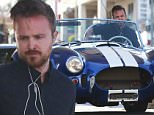 Picture Shows: Aaron Paul  March 27, 2015\n \n 'Breaking Bad' star Aaron Paul stops to fill up his 1965 Shelby Cobra while out and about in West Hollywood, California.\n \n Exclusive All Round\n UK RIGHTS ONLY\n \n Pictures by : FameFlynet UK © 2015\n Tel : +44 (0)20 3551 5049\n Email : info@fameflynet.uk.com
