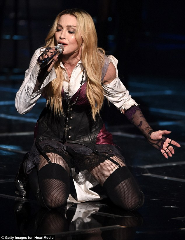 Madonna SITS DOWN During Performance With Her Guitarist
