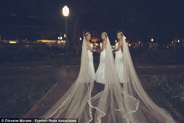 Event:The pews at the Nossa Senhora Aparecida catholic cathedral in Passo Fundo were moved apart to allow more space for the three brides to walk down the aisle together