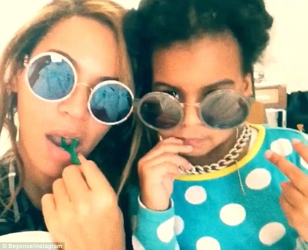 Just like mummy: Beyonce kick-started her Wednesday morning by sharing a short video clip of herself with three-year-old daughter Blue Ivy on Instagram