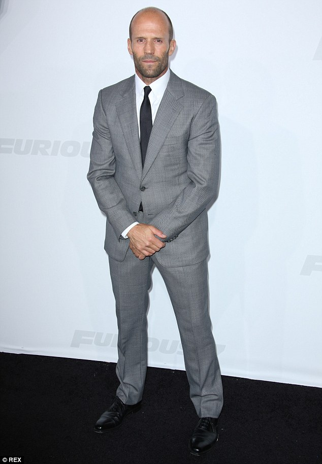 It suits him! Jason Statham, 47, stuck to his favored grey suit look
