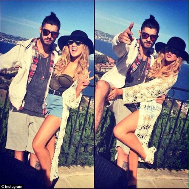 Defiant:Another snap, posted by Zayn's sister Walihya showed Zayn pointing at the camera, while Perrie posed with her tongue sticking out