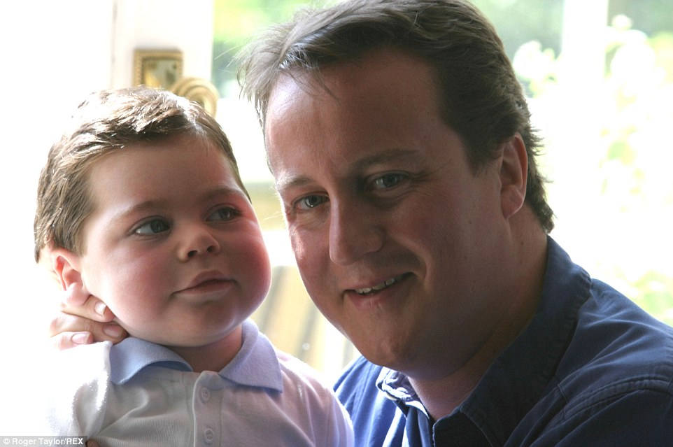 The Prime Minister pictured with his eldest child Ivan, who suffered from cerebral palsy, at their country home in May 2004