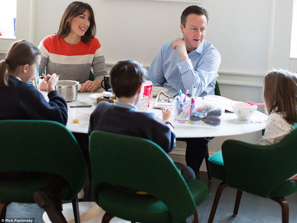 The most important meeting of the day: The Camerons pictured all sitting down and having breakfast together
