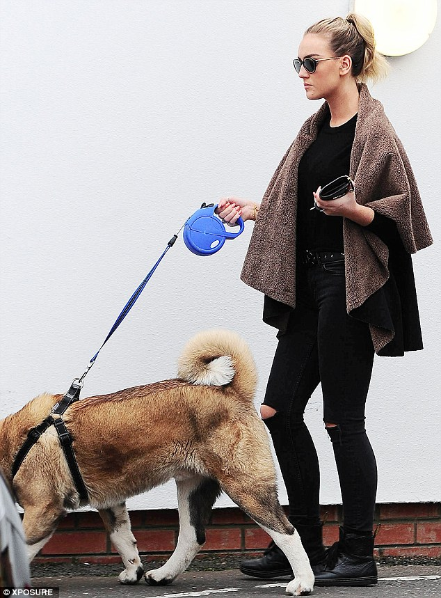 Just you and me: Perrie went to the vets to the solo, with Zayn nowhere to be seen as she headed out