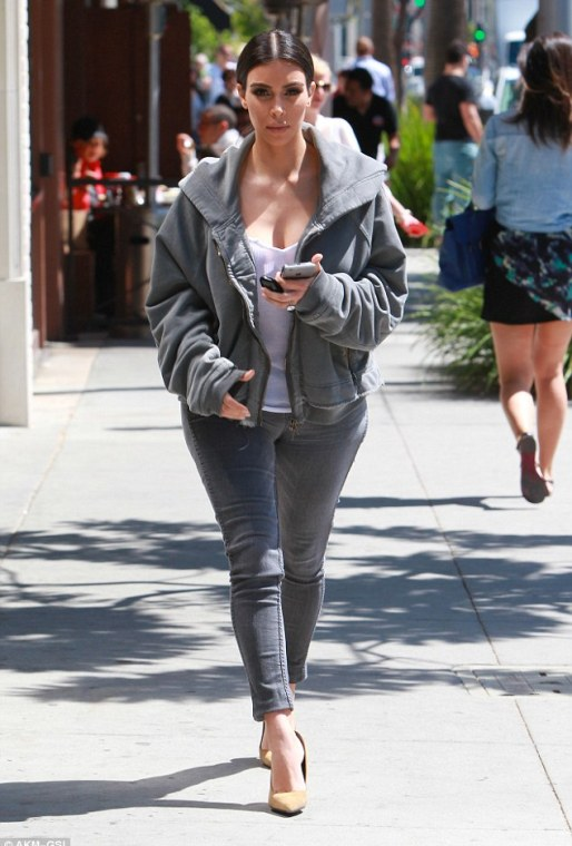 Boyfriend-style: Kim Kardashian wore an oversized hoodie with a hefty price tag of $1300 as she stepped out in LA on Monday