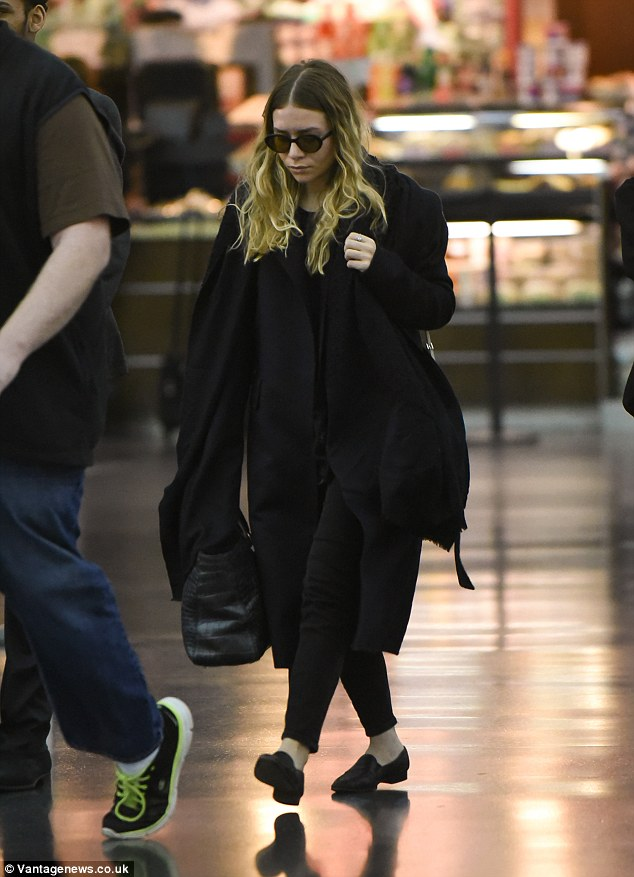 And she is off: Ashley Olsen speed through JFK airport as fast as her little loafers could carry her as she touched down in New York on Monday