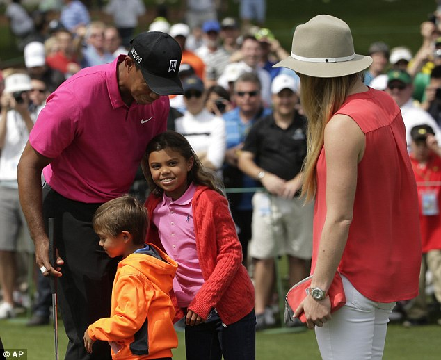 Happy family: Former world No 1 Tiger Woods enjoyed some quality time on the course at Augusta on Tuesday as he was joined by his children Sam, 8, and Charlie, 6, as well as longterm girlfriend Lindsey Vonn