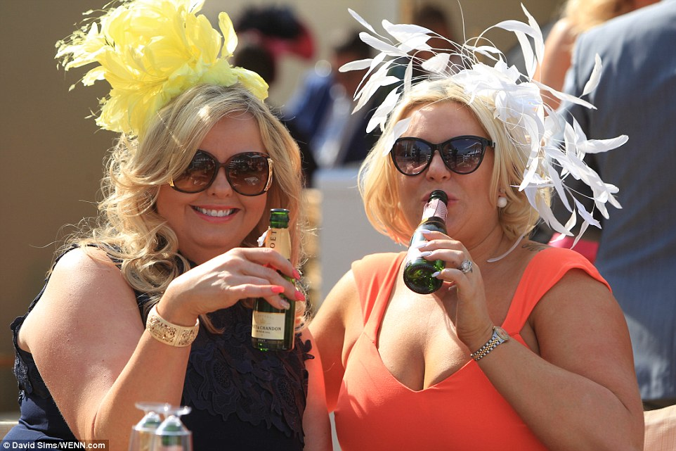 Cheers! A pair of ladies, both in spectacular fascinators, enjoy a bottle ofMoët & Chandon champagne