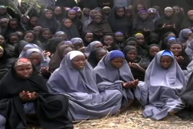 Screengrab taken on May 12, 2014, from a video of Nigerian Islamist extremist group Boko Haram shows girls wearing the full-length hijab and praying in an un...