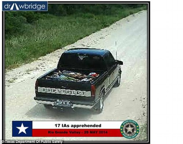A group of 17 'IAs' were apprehended after this truck was spotted driving along a dirt road across the border