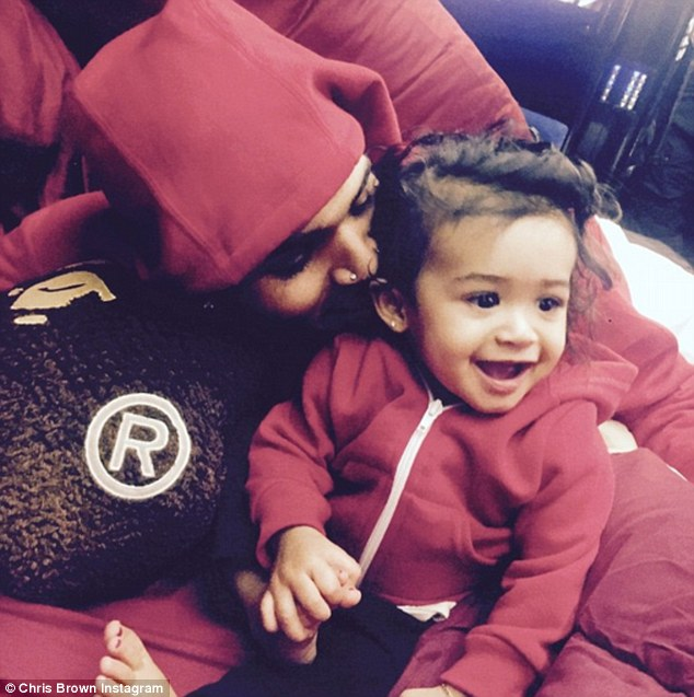 Besotted: Chris Brown posted adoring photos of his daughter Royalty to Instagram on Thursday night