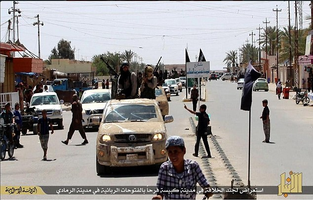 New propaganda photos from Anbar province claim that ISIS were warmly welcomed as they entered a nearby town near Ramadi.