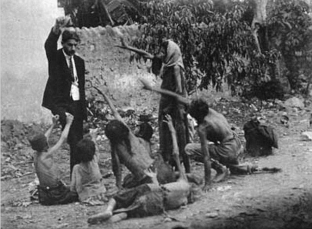 A Turkish official teases starving Armenian children during the genocide in Turkey in 1915