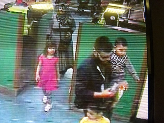 Police have warned that the Muslim family, who were last seen in Slough, Berkshire on April 7, may be heading to Syria. They are pictured at Dover port before catching a ferry to Calais, France on April 8
