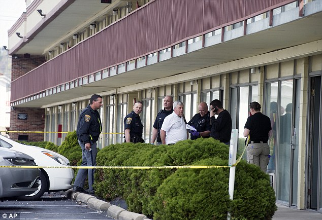 Tragedy: Police say a husband shot his wife and another man in the motel room they were sharing before turning the gun on himself early Sunday morning