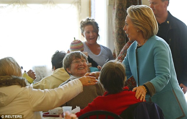 MEETING: Hillary was welcomed by people in the coffee shop - although not universally