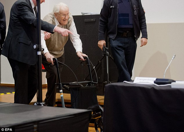 Trial: Groening is shown to his seat at the court house, flanked by police officers