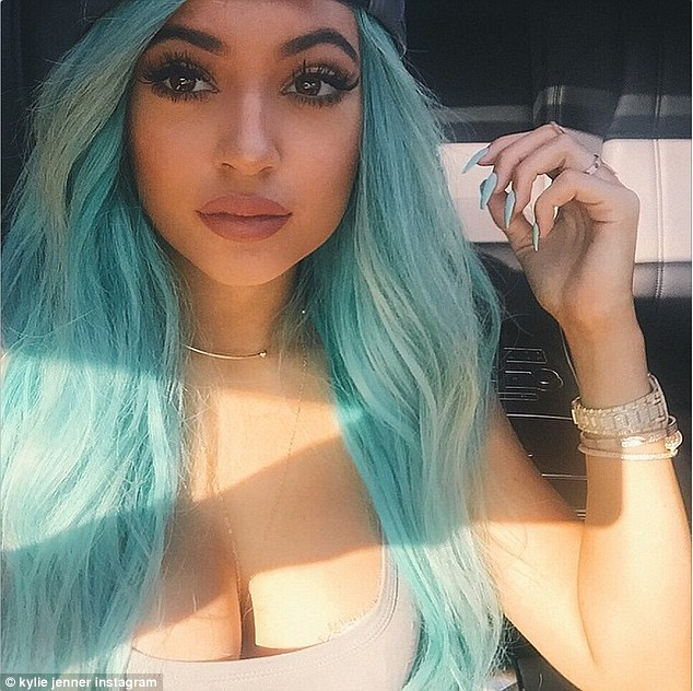 Reacting: Kylie Jenner took to Twitter on Tuesday to respond to the craze sweeping social media that is encouraging teenagers to plump up their lips to grotesque proportions using a shot glass - in an attempt to emulate the star