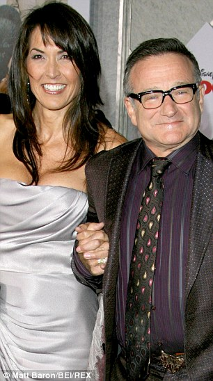 Suicide: Robin Williams with wife Susan Schneider in 2009
