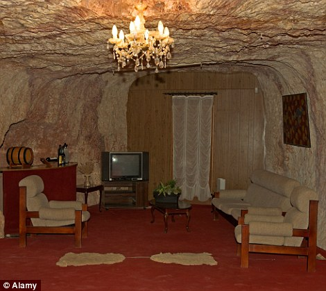 Miners who live in the area to collect opals, stay in dugouts underground