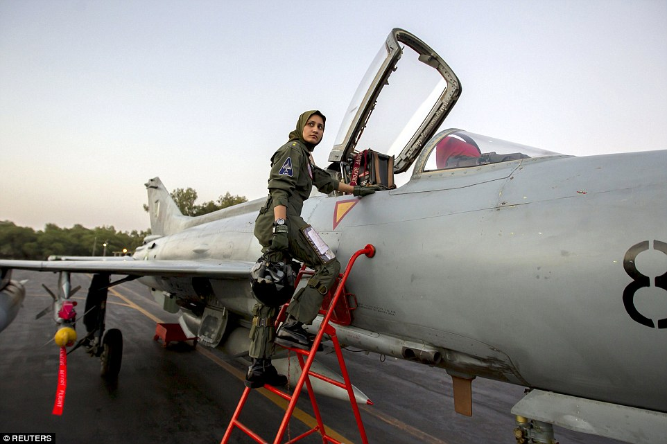 Taking flight: Ayesha Farooq, 26, Pakistan's only female war-ready fighter pilot, climbs up to a Chinese-made F-7PG fighter jet at Mushaf base in Sargodha, north Pakistan