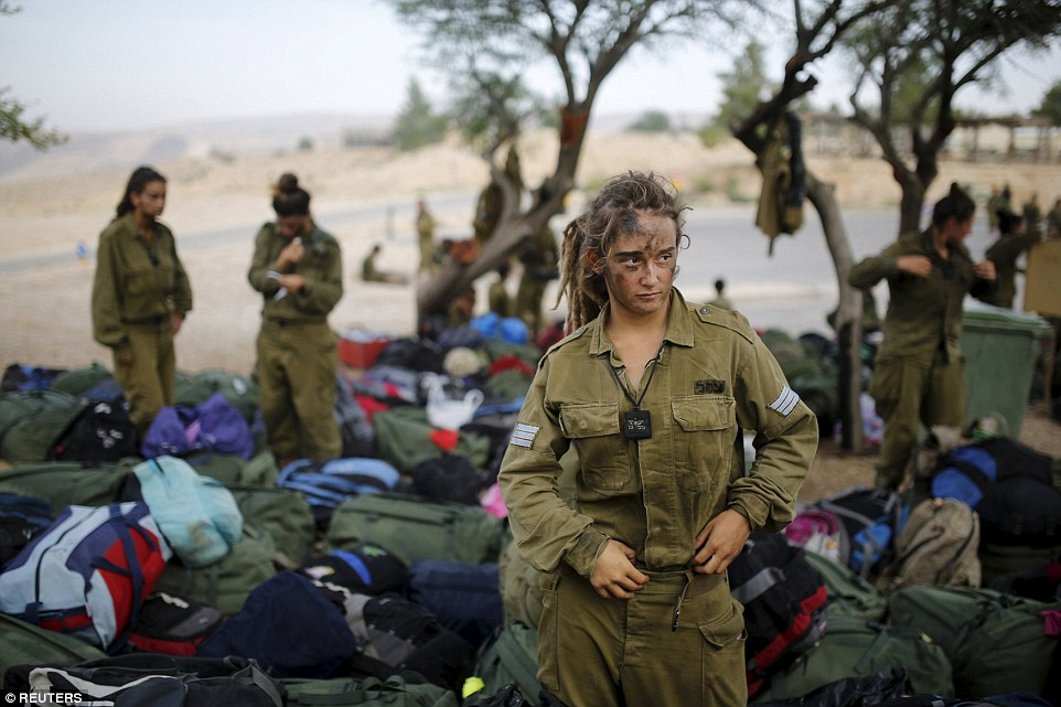 In training: An Israeli soldier of the Caracal battalion stands next to backpacks after finishing a 20-kilometre march in Israel's Negev desert, near Kibbutz Sde Boker in May last year