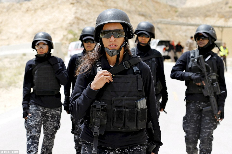On the march: Members of the Jordanian police women's team attend the 7th Annual Warrior Competition at the King Abdullah Special Operations Training Center in Amman, the country's capital on Wednesday
