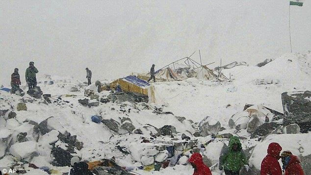 Devastating: At least 18 climbers were killed after the quake which buried tents at the base camp