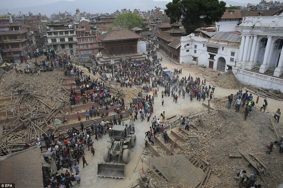 After: The square is now piled with rubble after tall temples were brought down by the force of the earthquake