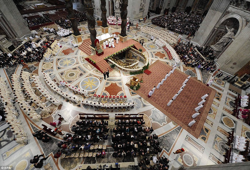 Into the priesthood: Newly ordained priests stand at St Peter's Basilica today during the mass of ordination presided over by Pope Francis