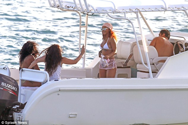 Now it's a party: The star was seen laughing with pals on a boat