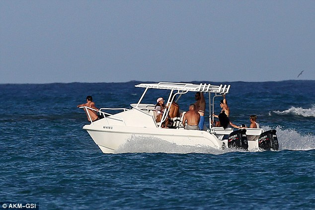 Sailing away: The party took off in their speedy watercraft