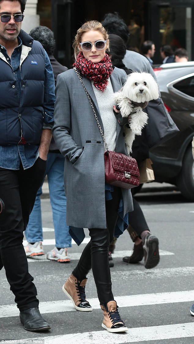 Chic: The fashionista looked lovely as ever in her grey coat, leather trousers and trendy shoes