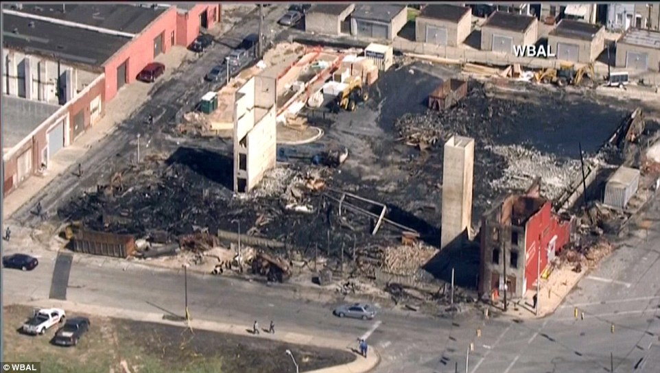 Ruins: The $16 million senior center can be seen to have been razed to the ground during the riots that hit Baltimore on Monday
