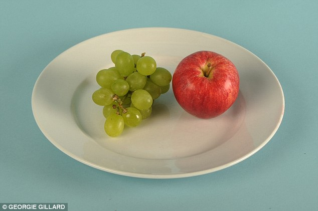 Good news for fruit lovers as one apple  and a handful of grapes makes for a healthy 100 calorie snack