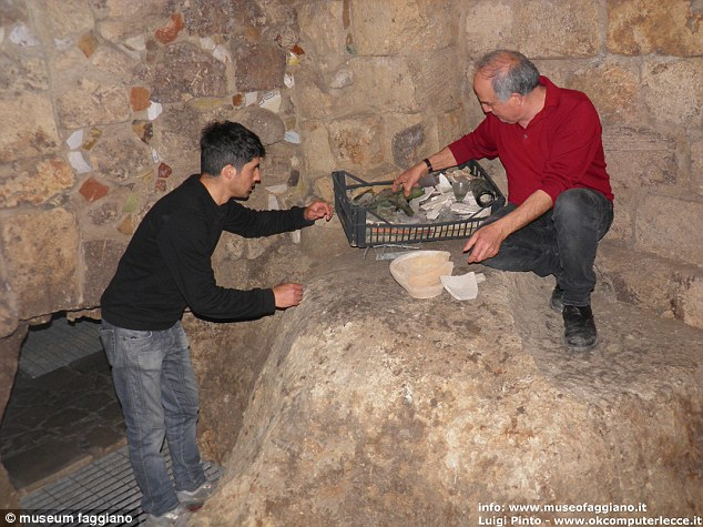 Afraid of costs and the delay in opening the restaurant, Mr Faggiano initially kept his amateur archaeology a secret from his wife. Here, he sorts though pieces of glass and pottery found in one of the rooms. There are even pieces embedded in the wall