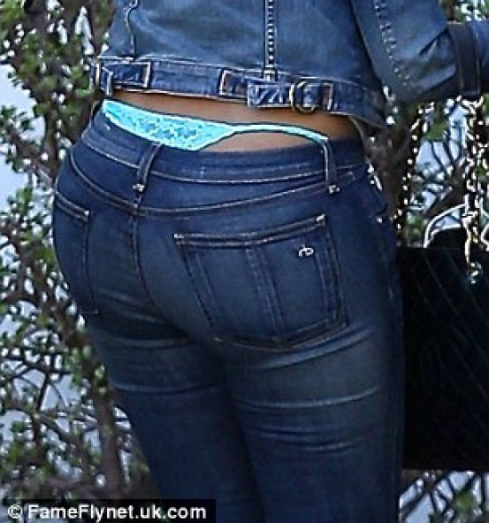 Flash: She displayed her turquoise thong that had become exposed over her bottoms