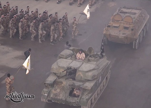 Force: The graduation ceremony was held for Jaysh Al-Islam's trainee soldiers who stood to attention as fleets of armoured vehicles drove past