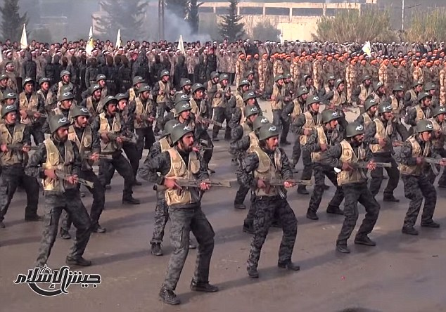 Aggressive: The soldiers of the Army of Islam perform a series of military drills (pictured) in what the group describes as the 'largest military parade witnessed' since the start of the Syrian revolution