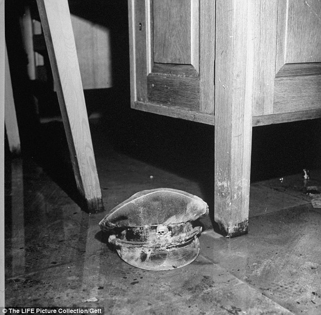 Already rotting: Mold covered Nazi SS officers cap on the bunker floor pictured not long after Hitler's death